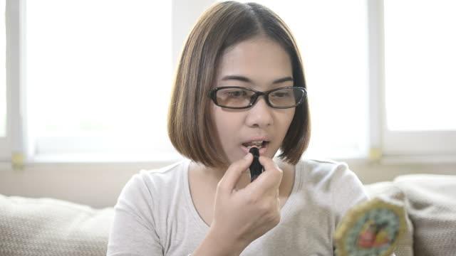 Beauty Teenage Girl applying Make up