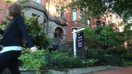 A Bediz Group LLC 'Sold' sign in Washington DC US on Friday Oct 17 gvs of the sign in front of the property Sotheby's International Realty sign...