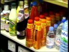 GV Beechams Lucozade drinks on shelf Beechams throat sweets on shelf CS Zovirax boxes on shelf