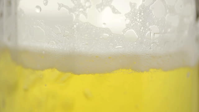 Beer is pouring in a glass