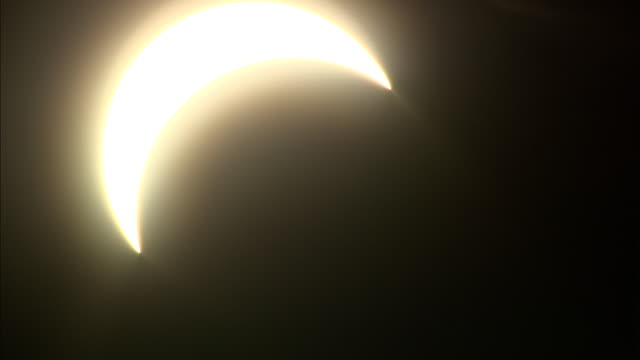 MS, Beginning of solar eclipse against dark sky