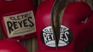 Behind one of boxing legend Muhammad Ali's last fights is a pair of Mexican hands that cut and stitched together the leather gloves that the boxer...