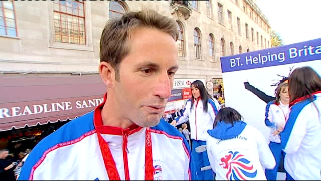 Team GB celebration and victory parade rushes Ben Ainslie interview about his Olympic achivement and the people's support SOT / Athletes on float...