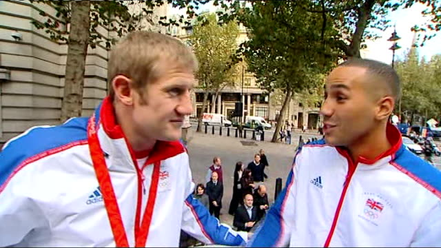 Team GB celebration and victory parade rushes General views of crowds in street from float / General views of Tony Jefferies and James DeGale and...