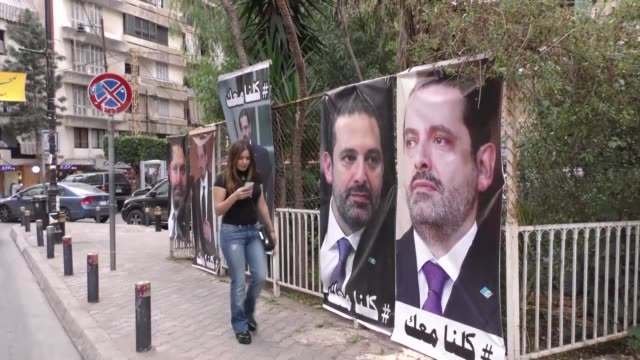 Beirut locals reacted Saturday to resigning Prime Minister Saad Hariri's trip to France