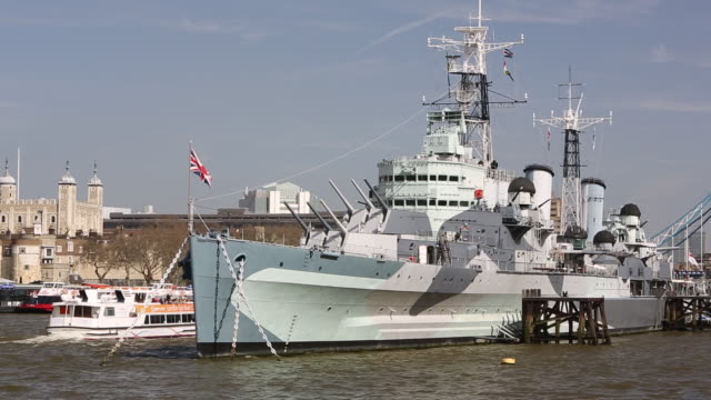 HMS Belfast on the River Thames with Tower Bridge in the background, London, UK.