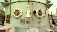 HMS Belfast reopens months after gangway collapsed into River Thames Phil Reed interview SOT Close shots HMS Belfast bell on ship Low angle view guns...