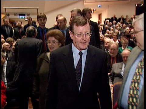 Belfast Waterfront Hall EXT MS David Trimble MP waving to cameras as along with wife to waiting car PAN as crowd cheer SOT INT David Trimble MP press...