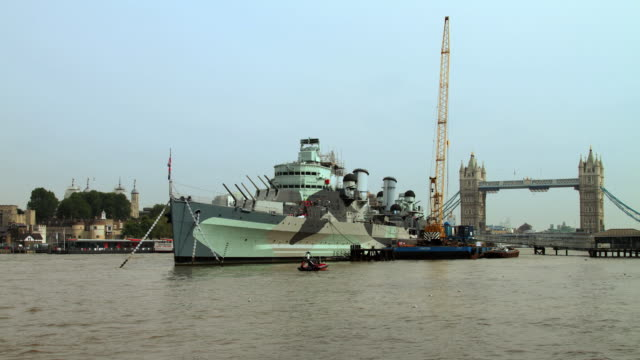 T/L WS HMS Belfast with Tower bridge and London Tower in background on Thames River / London, United Kingdom