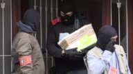 Belgian police carry out a raid at a house in Anderlecht in Brussels