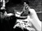 Belgium's King Baudouin marries Spain's Dona Fabiola as they kneel before priest and shake hands with him King Baudouin marries Dona Fabiola on...