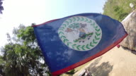 CU Belize flag blows in the wind