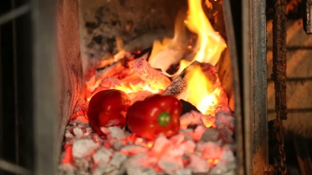 bell pepper in flaming coal