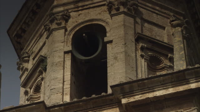 A bell rings in the bell tower of the San Biagio Church in Italy.