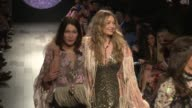 Bella Hadid Gigi Hadid Taylor Hill and their fellow models on the runway for the Anna Sui Ready to Wear Spring Summer 2018 Fashion Show in New York...