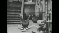 Buster Keaton is bouncing on a lodged piece of wood in the hotel lobby holding a telephone, the hotel receptionist takes the phone from him and cuts the wood with a saw, finally stopping Keaton from bouncing and causing him to fall to the floor