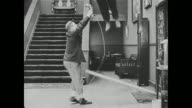 Buster Keaton's supervisor unsuccessfully tries to help him stop bouncing on a piece of wood, so he hands Keaton the phone, runs into the phone booth, and calls him