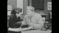 Bellmen Buster Keaton and Fatty Arbuckle ignore other customers so they can devote all of their attention to a woman (Alice Lake) in a fancy whose business card that reads 'Miss Cutie Cuticle, Manicure'