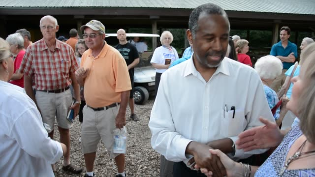 Ben Carson speaking to supporters outside one by one after speech