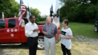 Ben Carson talking with and taking pictures in front of an Iowa pickup truck