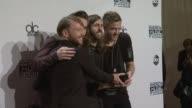 Ben McKee Daniel Platzman Daniel Wayne Sermon and Dan Reynolds of Imagine Dragons at the 2014 American Music Awards at Nokia Theatre LA Live on...
