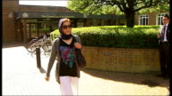 London Isleworth EXT Afghan asylum seeker Toorpakai Saiedi away from court after escaping being jailed for benefit fraud and into car