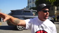 Benjamin Bac Sierra wearing a shirt with a fist that reads 'Frisco Resitance' talks about shutting down the Patriot Prayer rally near Alamo Square in...