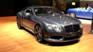 CU Bentley wall logo ZOWS front end of Bentley Continental coupé / PAN LEFT to WS driver side profile / CU Bentley logo on steering wheel ZOMS...