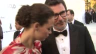 Berenice Bejo and Michel Hazanavicius on the importance of amfAR at 2012 amfAR's Cinema Against AIDS on May 24 2012 in Cannes France