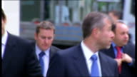 Berezovsky seeks compensation from Abramovich ENGLAND London Royal Courts of Justice EXT Roman Abramovich arriving at court with entourage Boris...