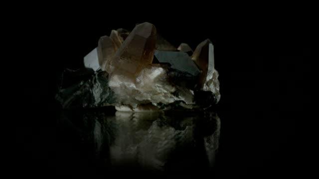 Berg crystal rotating on black
