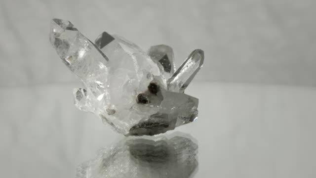Berg crystal rotating on white background
