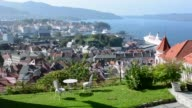 Bergen Norway aerial of the city from above mountain of city water and cruise ship beautifukl old city