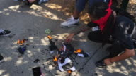 Protesters burn a Thin Blue Line American flag that honors fallen police in Ohlone Park in Berkeley A huge crowd gathered nearby at Martin Luther...