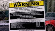 Slough EXT Clamp warning poster Boarded up property Posters warning of fines for illegal parking Clamped wheel Paul Watters interview SOT Officer...