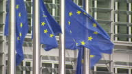 Berlaymont Building exterior with European Union flags waving in wind EU Berlaymont Building exterior stockshots EU Headquarters on June 03 2013 in...