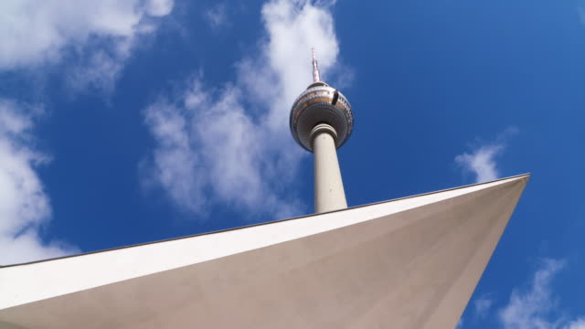 Berlin Fernsehturm (TV tower) with moving clouds. Berlin, Germany.
