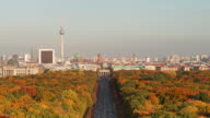 Berlin Skyline over colorful Autumn Tiergarten in front of Brandenburg Gate with Traffic
