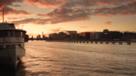 Berlin Spree Skyline in Summer with Train and Sunset