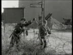 Berlin Wall collection TX 1381961 Barbed wire erected West Berlin group of West Berliners watch East German soldiers put up barbed wire barriers...