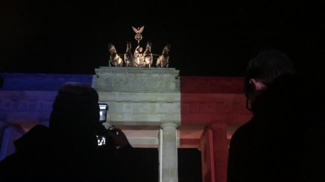 Berlins iconic Brandenburg Gate shines with the colours of the French flag in solidarity with Paris after last nights attacks over the French capital