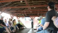 Bernie Sanders speaking to a group of supporters in Indianola Iowa on a hot rainy day