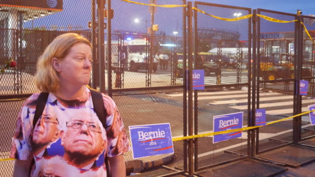 A Bernie supporter wears a shirt with images of Bernie Sanders on it while protesting near the entrance to the Democratic National Convention as...
