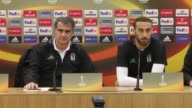 Besiktas' head coach Senol Gunes and forward Cenk Tosun attend a press conference the day before the UEFA Europa League Round of 32 first leg soccer...