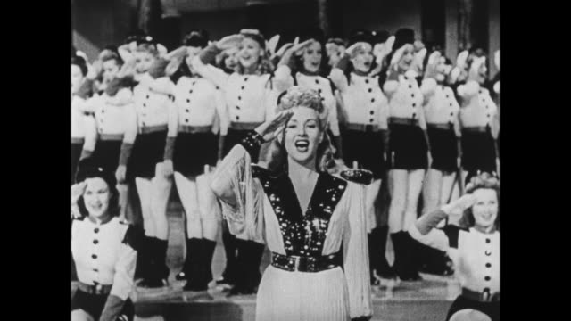 Betty Grable and the Bombardiers end their musical number