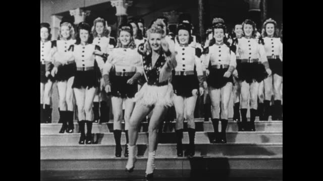 Betty Grable and the Bombardiers tap dance in high hells