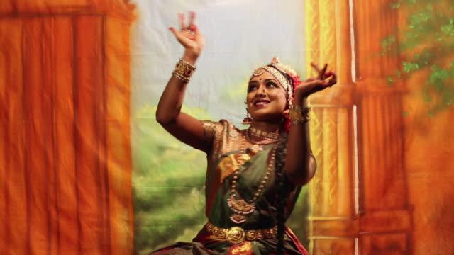 Bharatanatyam dancer performing on the stage, Delhi, India