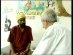 15 year on ITN Farah Khan interviewed SOT Describes memory of disaster Sathyu Sarangi sitting working at computer EXT Sarangi sitting with Snow...