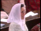 Bhutto wins no confidence vote PAKISTAN Islamabad Parliament Chamber Benazir Bhutto speaking TMS MP banging fists on tables behind Bhutto TCMS...