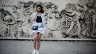 Bianca Derhy fashion blogger Bibi Goes Chic wears a Shein skirt with embroidered flowers a Rails top with lace Converse white sneakers shoes and a...